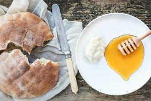 Butter cream, flatbread and honey