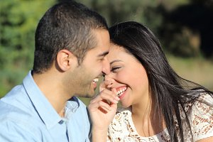 Arab casual couple man and woman flirting and laughing happy in a park.jpg