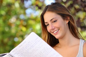 Beautiful teenager girl studying outdoor.jpg