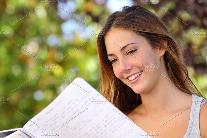 Beautiful teenager girl studying outdoor.jpg - Education