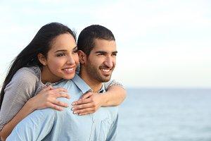 Arab couple flirting in love on the beach.jpg