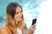Casual woman using a smart phone.jpg
