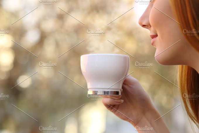 Close up of a woman holding a coffee cup.jpg - Food & Drink