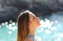 Girl breathing fresh air on a tropical beach on holidays.jpg