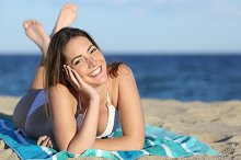 Happy woman with white perfect smile resting on the beach.jpg