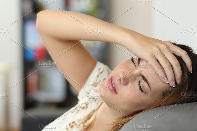 Housewife woman in a couch with headache.jpg - Health