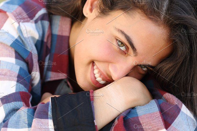 Portrait of a beautiful teenager girl smiling and looking at camera.jpg - Beauty & Fashion