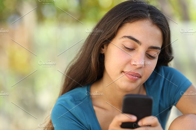 Pretty teenager girl texting in a smart phone.jpg - Technology
