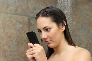 Teenager in the shower obsessed with the smart phone.jpg