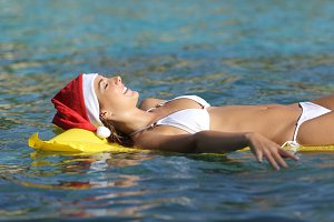 Woman enjoying on the beach on christmas holidays.jpg