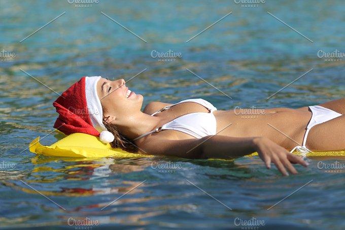 Woman enjoying on the beach on christmas holidays.jpg - Holidays