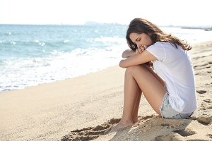 Worried woman on the beach.jpg