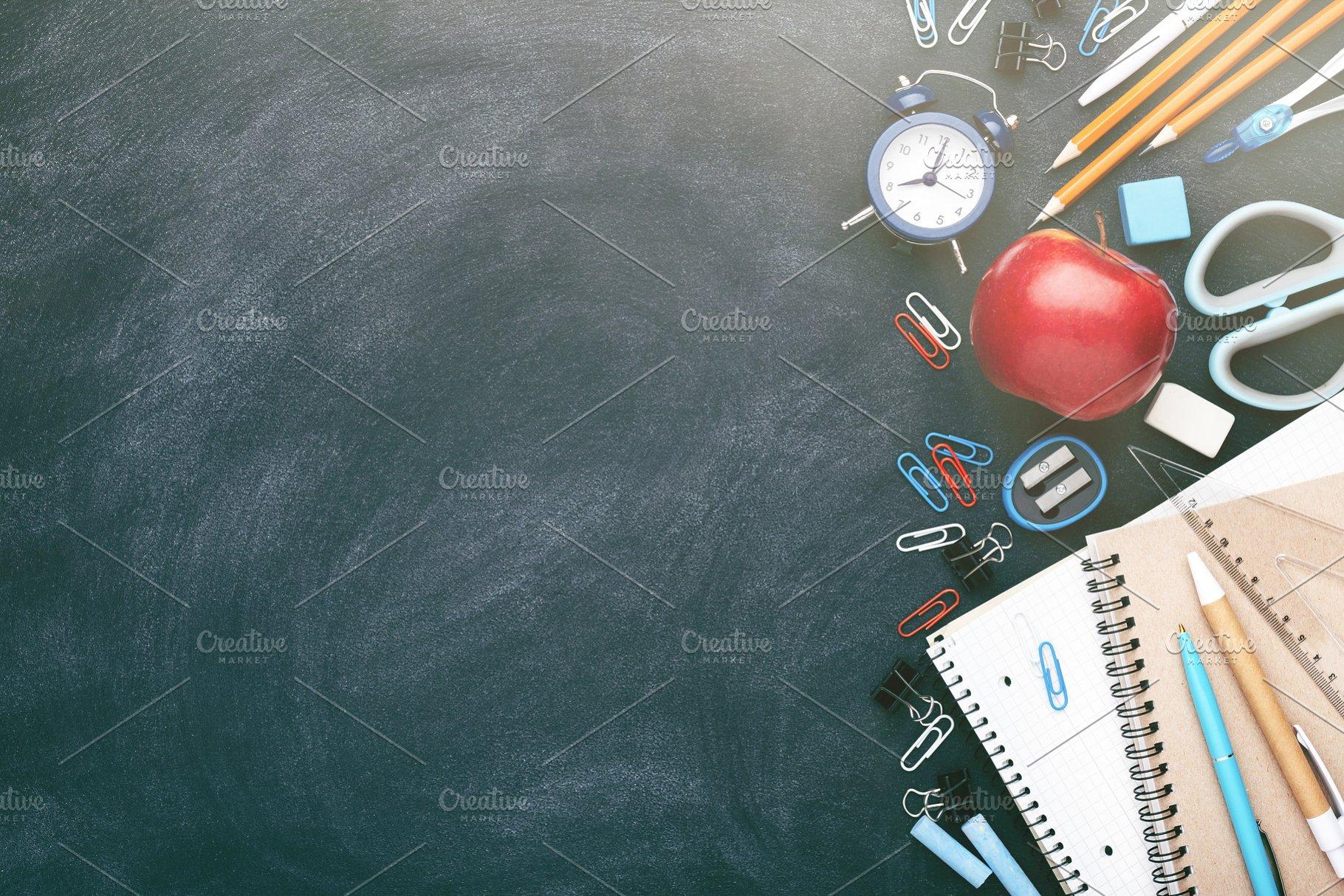 School stationary on blackboard.