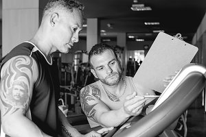 personal trainer instructing man