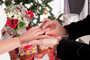 Man putting wedding ring on finger