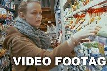 Woman in grocery choosing food