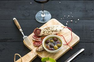 Glass of red wine & french sausage