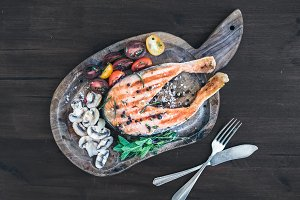 Grilled salmon steak with herbs