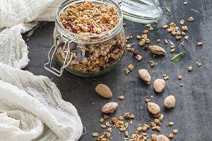 Oat granola in open glass jar