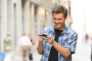 Man playing game with a smart phone.jpg