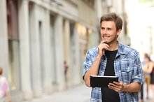 Man with a tablet thinking in the street.jpg