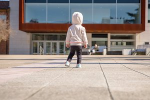 Little girl with sneakers and hoodie