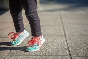 Girl legs with sneakers and leggins