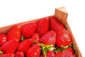 Box corner of strawberries isolated