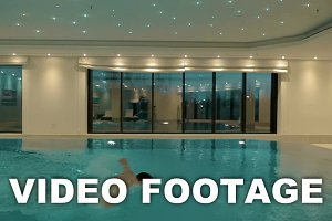 Man swimming alone indoor pool