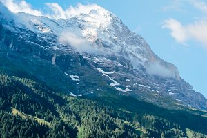 Top mountain surrounded with snow