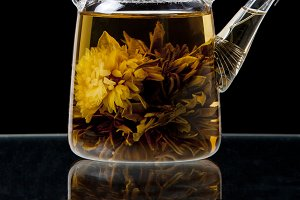 Green flower tea in teapot