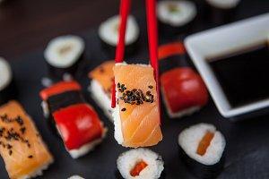 Sushi held in chopsticks