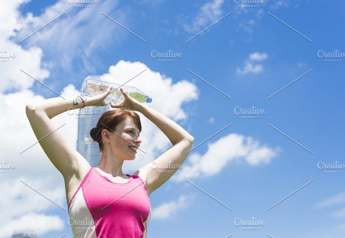 Cute Girl holdong a Bottle of Water.jpg - Sports