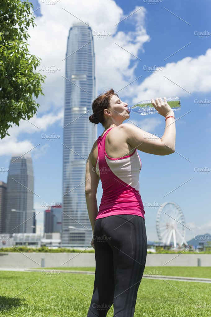 Woman with a Bottle of Water.jpg - Sports