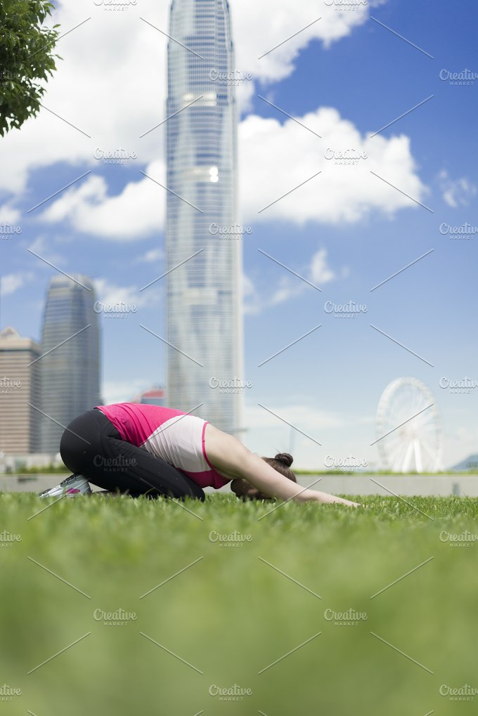Woman stretching after running.jpg - Sports