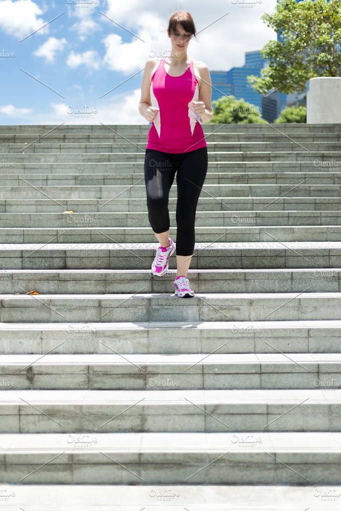 Woman running down Steps.jpg - Sports