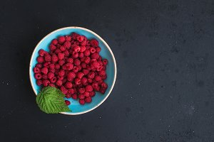 Fresh garden raspberries in bowl