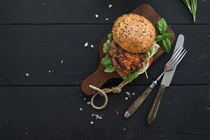 Homemade burger on serving board
