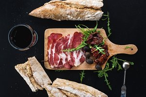 Smoked meat on rustic wooden board
