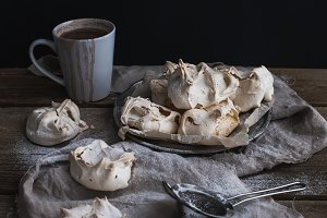 Meringue and mug of hot chocolate