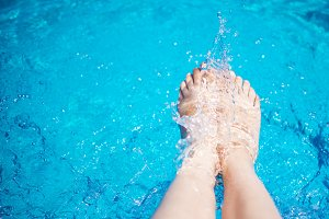 The feet of woman who makes a splash