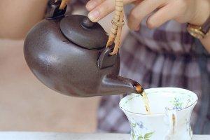 women pouring tea