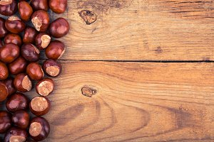 chestnut on old wooden background