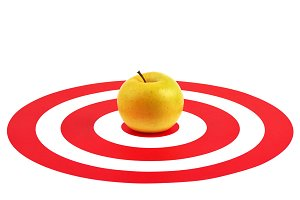 Apple in the center of red target