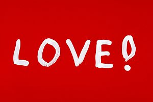 Love word painted over red