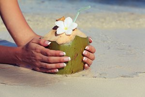 Coconut in the hands of the girls