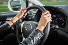 Woman's hands on the steering wheel