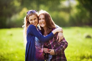Two young girl  together in hug