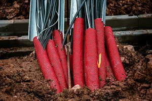 Plastic pipes containing electric cables