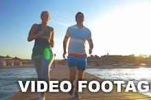 Couple Jogging on the Sea Pier